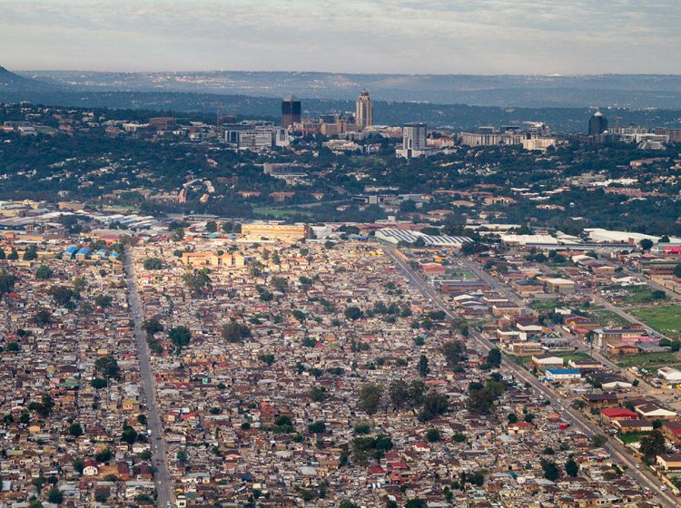 Alexandra township and Sandton business district in Johannesburg: Inequality in South Africa's cities and towns is strong driver of violence and crime.